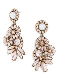 A gorgeous, ornately organic statement earring that features a bouquet of blooms bursting from a prim pearl post.