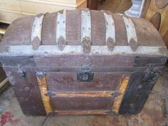 This antique humpback trunk has a unique, crocodile embossed metal trim as well as original artwork on the interior lid. Trunk is in original condition. Vintage Storage, Metal Trim, Crocodile, Storage Chest, Original Artwork, Trunks, The Originals, Antiques, Interior