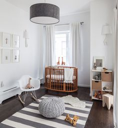 25 Creative and Beautiful Nursery Design Ideas via Brit + Co. White and natural wood nursery with an oval crib Wood Nursery, Nursery Neutral, Nursery Room, Girl Nursery, Wood Crib, Nursery Stripes, Nursery Colours, Grey White Nursery, Bright Nursery