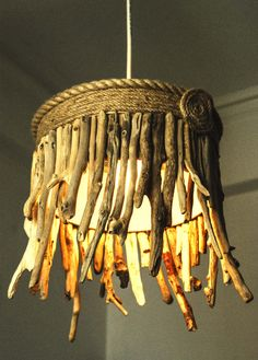 Black Friday/Cyber Monday,Driftwood Hanging Light Chandelier / Table Lamp, Coastal Chic Lamp, Rope Lamp, Hanging Light, Sunburst Lamp. $140.00, via Etsy.