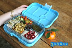 Mediterranean diet inspired packed lunch. This Yumbox has an orzo pilaf with roasted veggies, oregano and lemon poached chicken breast, stuffed grape leaves, salad of tomatoes, peppers and cucumbers, kalamata olives and yogurt with pomegranate seeds.