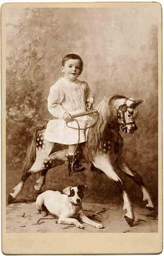 +~+~ Antique Photograph ~+~+  Charming portrait with a child on an exquisite toy horse and a dog at her side.