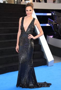 Pin for Later: You Only Need 13 Reasons to Start Obsessing Over Gal Gadot's Style  For the London premeire of Fast & Furious 6, Gal showed up in a sparkly gown with a plunging neckline.