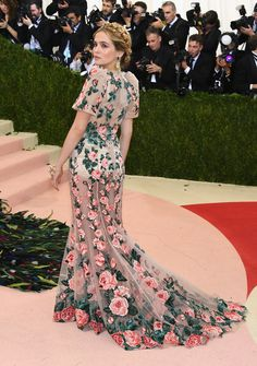 Zoey Deutch in a sheer floral dress.