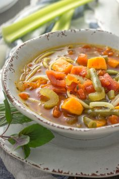 This vegetarian Whole30 soup is inspired by classic minestrone, using sweet potatoes and zucchini noodles! A delicious and quick fall soup recipe!