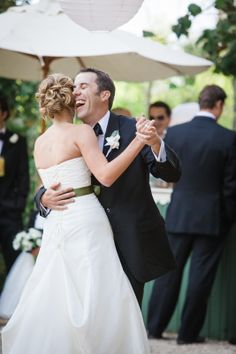 Bride and Groom's first dance. Love the laughing and candid moment between a new wife and husband.  http://www.brandonerica.com