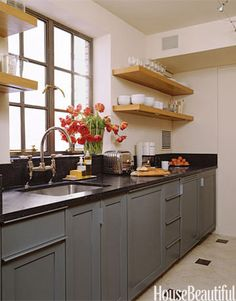 """It might be difficult to imagine a big-time cook like Ina Garten in a small kitchen, but she actually prefers this little gem in her Manhattan apartment, featured in House Beautiful in May 2007. """"Let's just say that when I bought this apartment, I told my husband we could just fix the kitchen, paint it white, and move in,"""" she says. """"Then I talked to my architect, Richard Lewis, and he said, Total gut job. We did a really streamlined kitchen with a cooktop, an under-the-counter refrigerator…"""