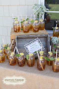 Add a sweet tea station to your Bridal Shower! This rustic themed station is complete with mason jars and pink straws!
