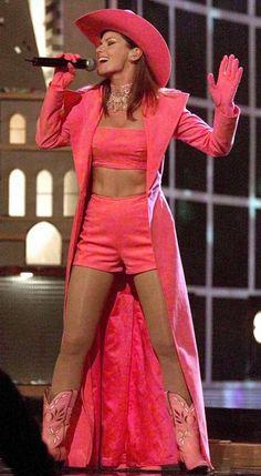 Shania Twain performing in pink