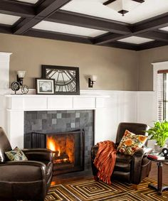 "Restored Craftsman Sensibility | Updating a Cozy Craftsman | This Old House ""The living room fireplace got a new slate-tile surround and wood mantel over formerly built-up brick. Light fixtures throughout the house are Craftsman-style reproductions."""