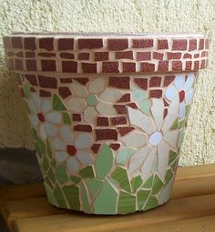 Flower pot with white flowers.