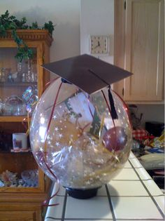 A balloon with a gift card/album inside