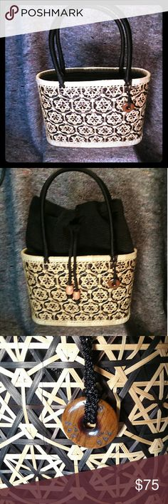 Wicker purse Simple chic and versatile hand bag. Two bags in one simple hand bag for your wallet and purse can turn into a picnic bag. Black drawstring cloth can extend over what you pack in. Like new no visible signs of damage Saks Fifth Avenue Bags