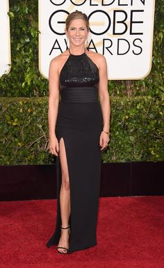 "Jennifer Aniston dared to show a little leg in a Saint Laurent gown and changed things up a bit from her normal red carpet look with her hair pulled back. The 45-year-old actress is nominated for her role in ""Cake."""