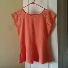 Coral peplum top Coral top. Peplum style. Short sleeves. Lace sleeves and part or beck. Buttons down lace portion of back.100% polyester. Annabella Tops Blouses