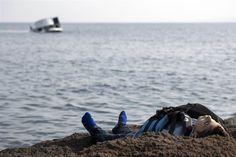 The dead body of a migrant boy lies on the beach near the Aegean town of Ayvacik, Canakkale, Turkey on Jan. 30, 2016. A boat carrying migrants to Greece hit rocks off the Turkish coast on Saturday and capsized, killing at least 33 people, including five children, officials and news reports said. Some 75 other migrants were rescued.