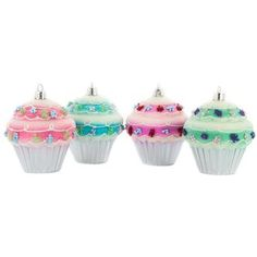 """Have a holly jolly sugary Christmas! Cupcake Ornaments are constructed of plastic, are shatter proof, and feature pink, purple, blue, and green cupcakes with glitter, bead sprinkles, and shiny silver liners. These cupcakes are perfect for hanging on your tree or setting on a flat surface as Christmas decor. Indulge in your sugar cravings with these delicious completely not-edible ornaments.    Dimensions:      Length: 3""""    Width: 3""""      Each box contains 4 ornaments."""
