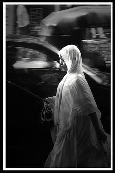 Jain Sadhvi - I love this photo! grace and determined focus amidst the hustle and bustle of daily chaos