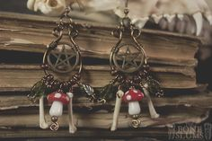These earrings are over the top, and only for those who seek to draw attention to themselves and their love of the forest! With tiny glass, red and white spotted mushroom glass beads, threaded onto brass wire with small brass beads and handmade brass spiral  bead pins. On either side of each mush...