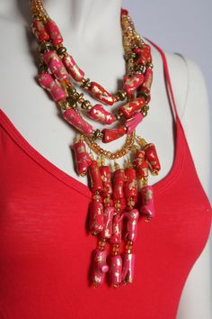 Cranberry Coral Statement Necklace / Red and Pink Coral Necklace / Bib Fringe Necklace / Chunky Coral Jewelry by BossyMossyBeads on Etsy https://www.etsy.com/listing/172645754/cranberry-coral-statement-necklace-red