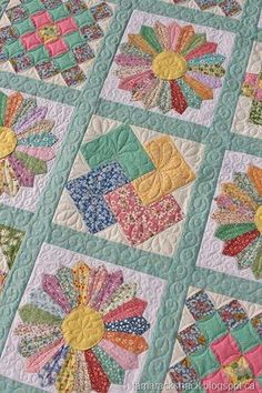 This is Linda's Dresden Plate quilt and it is made with reproduction fabrics. This will be a wedding gift for her granddaughter who loves vintage things so this will be the perfect gift!