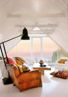 A small room, with big window and large, comfortable furniture - providing a fabulous view!