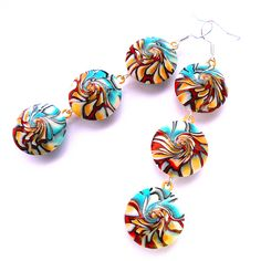 Each of these handmade earrings is made of three beads in the form of lentils, which I made with my own hands. I made them from polymer clay of different colors, which I mixed and twisted in a special way. More: https://www.etsy.com/listing/575920134/red-blue-handmade-earrings-swirl