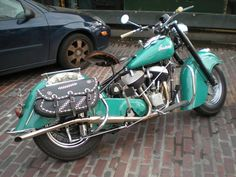Sweet Indian...such a pretty bike...I love saddle bags...it's the country in me :)
