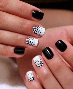 Black and white manicure on short nails looks impressive and elegant. The shine of dark covering shades light polish, that is decorated with patterns of do