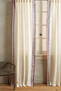 Thayer Curtain #anthropologie A cheaper version would be to take basic curtains and sew on a border.