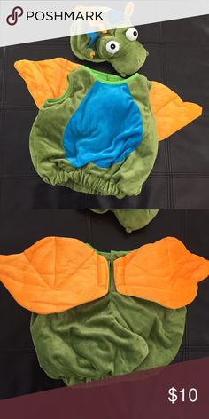 Dragon Costume Padded body suit (sleeveless and legless) with padded character hat. The wings are velcroed on. Worn only once 😊 Perfect condition! Costumes