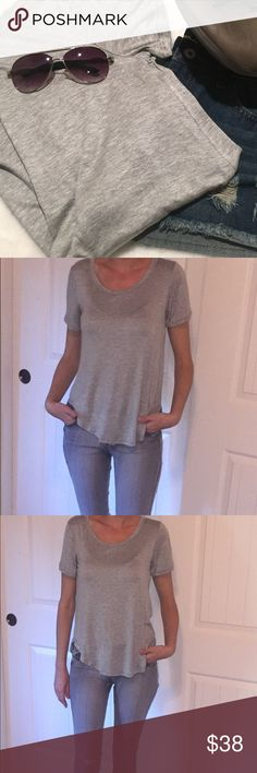 """✨ New Listing ✨Classic Heather Gray Staple Tee One of the softest Tees you will ever own. A must have staple that is so comfy you won't want to take it off! Had to keep one for myself.  ⭐️ Made in the USA ⭐️Fits True to Size ⭐️Rounded Neck & Hem ⭐️ Rayon/ Spandex   (If """"applicable""""this item includes sales tax reimbursement computed to the nearest mil') Tops Tees - Short Sleeve"""