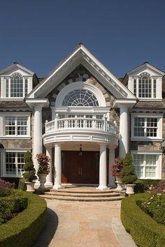 Traditional Front Door with Formal garden, Columns, exterior stone floors…