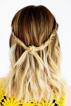 Lovely festival style for medium hair. Two fishtail braids knotted together. SUPER easy!