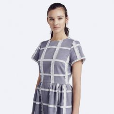 The Patricia Dress is a staple reassembled. Waist pleating and our signature check give this classic, easy-fitting piece a fresh look. Japanese cotton; dry clean only; fits true to size. Made in New Y