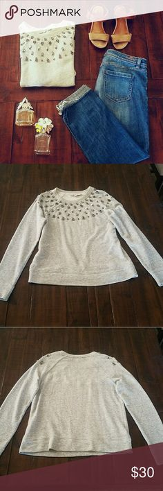 Sweater Grey sweater with designs on decollete area up through shoulders. Are a little heavy. LOFT Sweaters Crew & Scoop Necks