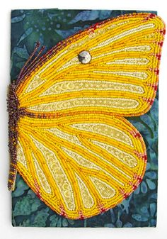 """I ❤ beadwork . . .  Mom and Me Bead Journal Project for Nov., 2008. Bead embroidery on two fabrics. A dominate event during this month is a visit to my 92-year-old Mom, who lives in Minnesota. The piece is actually a """"book."""" The butterfly wing opens to reveal a 6-page book of photos & journaling about my Mom (& me)! This November BJP is a testament to our cherished relationship! ~By Robin Atkins"""