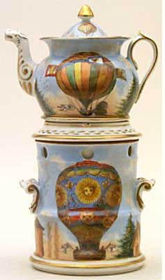 Teapot #348  Conventional, with side handles to stand, insert for hot water, conforming pot, sky blue and white; balloons on stand and pot and inscription telling of first balloon ascensions. Signed V. Verlac 1835.  Acquired in Paris