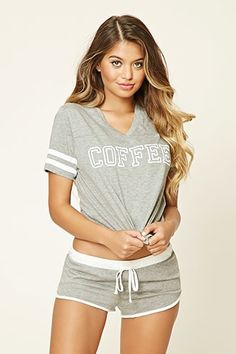 "A set of heathered knit PJs featuring a tee with a V-neckline, short varsity striped sleeves, and a ""Coffee"" graphic on the front, as well as a pair of shorts with a contrast elasticized drawstring waist and a contrast dolphin hem. Cute Sleepwear, Lingerie Sleepwear, Nightwear, Loungewear, Cute Pjs, Cute Pajamas, Pijamas Women, Babydoll, T Shirts For Women"