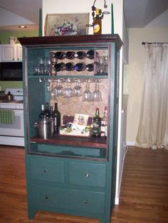 Old armoire used for big TV transformed into a bar. Removed two large front doors, and adapted the interior. Work involved was minimal.