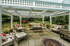 Lattice covered outdoor living room.