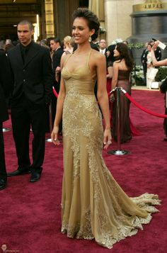 Red Carpet Beauty Jessica Alba dazzles in golden Versace with lace embroideries at the 2006 Academy Awards.