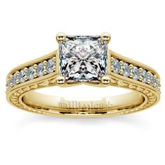Love vintage beauty with a modern edge? The Antique-style Floral Diamond Ring in Yellow Gold with a Princess-cut center is the perfect ring for you, with its classic metal, elegant pave diamonds, and delicate  floral detailing!  http://www.brilliance.com/engagement-rings/antique-floral-diamond-ring-yellow-gold-1/2-ctw