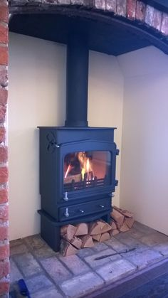 A Woodwarm Fireview stove with a profiled flat top.