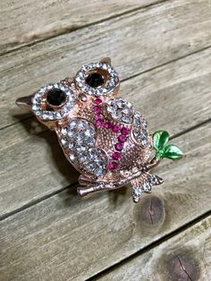 A beautiful sparkling rhinestone owl, message envelope with note paper and handmade glitter topped gift box.