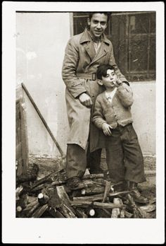 Refik Veseli with Gavra Mandil, the Jewish child he is hiding in his home.
