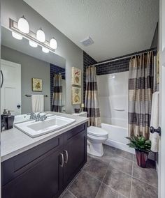 Ideas to update a fibreglass tub and shower surround with dark subway tile by Stepper Homes