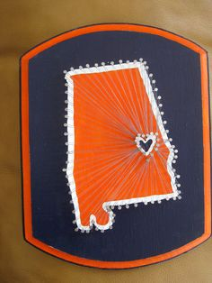 State pride- Nail and string on a painted wooden plaque- Auburn University. $30.00, via Etsy.