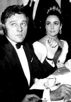 Liz and Dick. (She's wearing one pair of emerald earrings he gave her - what a husband!)  Hair by Alexandre de Paris.