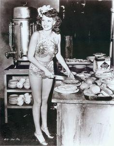 Historic Photograph of Rita Hayworth Cuts Pies At The Hollywood Canteen